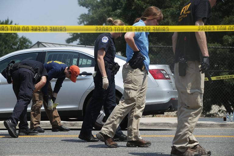 Police inspect the crime scene after an attack on lawmakers