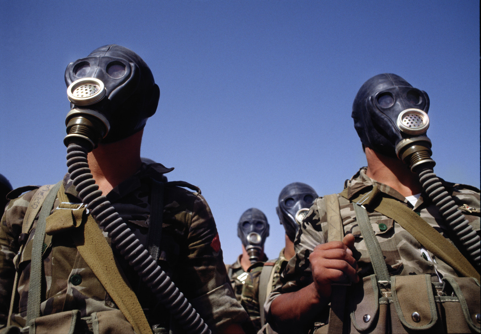 Soldiers wearing gas masks